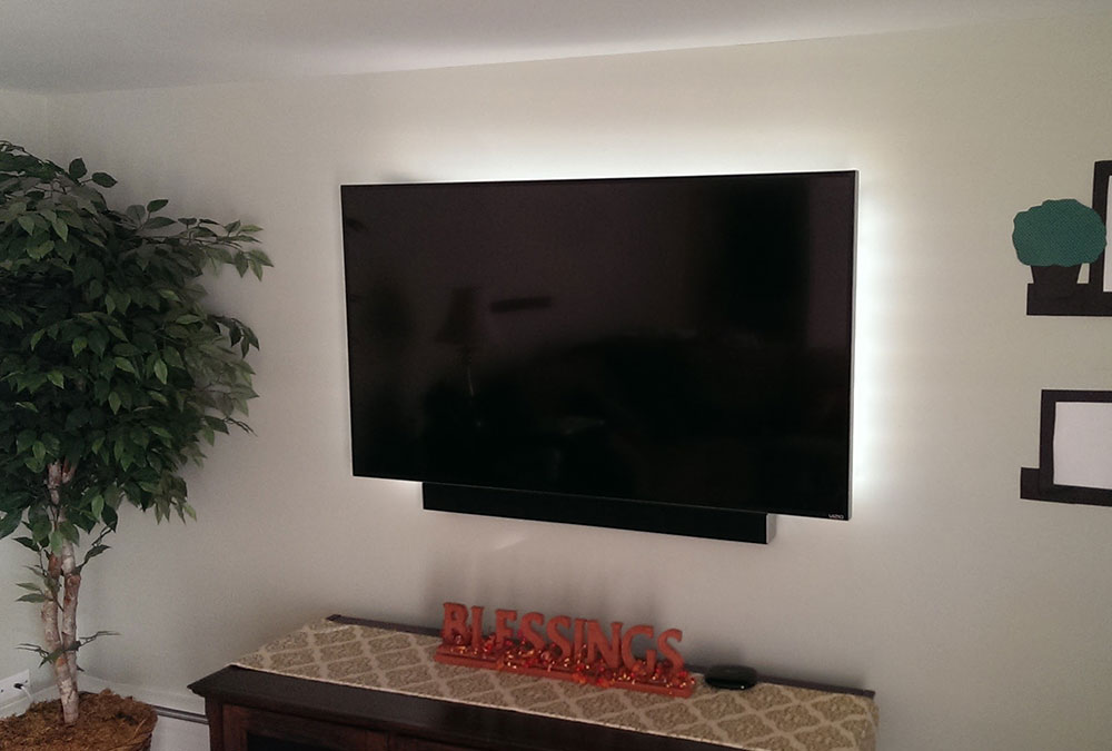 TV Mounting with Soundbar and LED Backlights